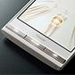 耐衝撃性能やハードキーを装備した上質感のある新端末「URBANO V01」を発表